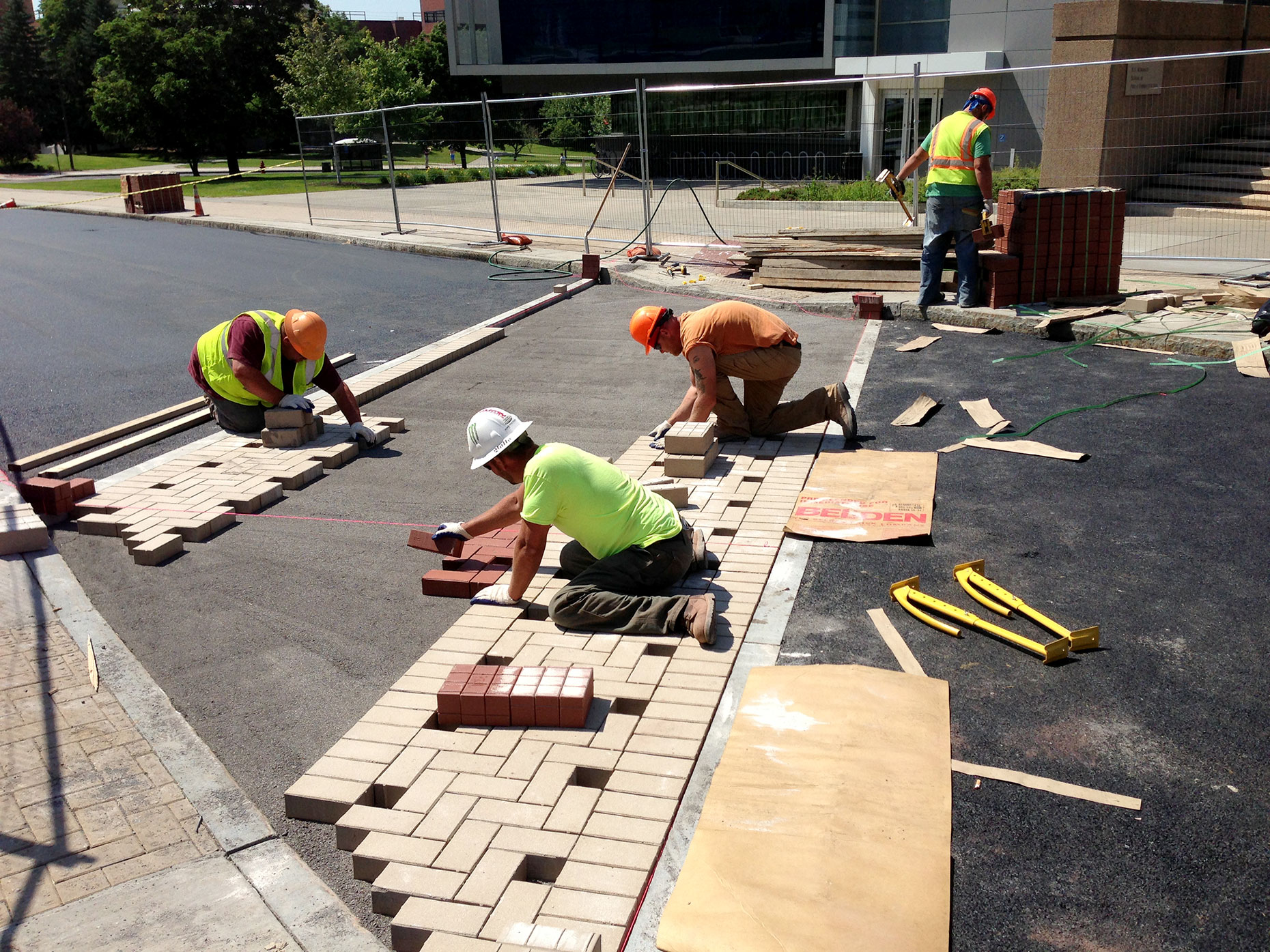 Workers aligning bricks